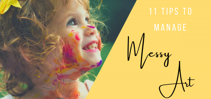 Smiling toddler with paint on her face