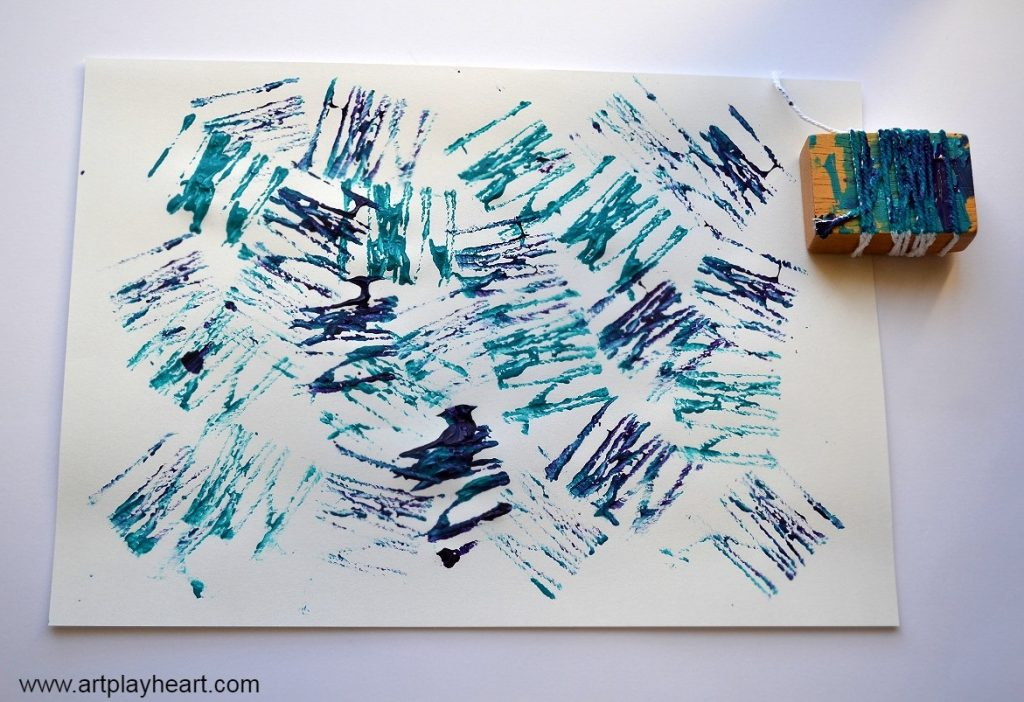 Painting with blocks and twine