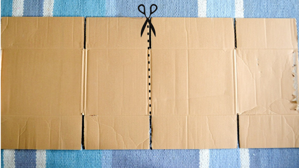 Cardboard easel directions and scissors symbol of where to cut