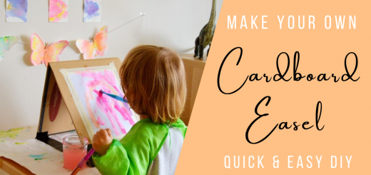 Toddler painting at cardboard easel